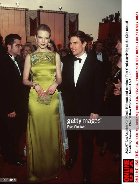 Married actors Tom Cruise and Nicole Kidman attend the 69th Annual Academy Awards Los Angeles California March 24 1997 Kidman wears a green...