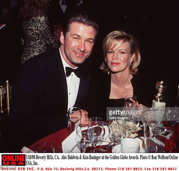 Married American actors Alec Baldwin and Kim Basinger sit at a table during the Golden Globe Awards ceremony held at the Beverly Hilton Beverly Hills...