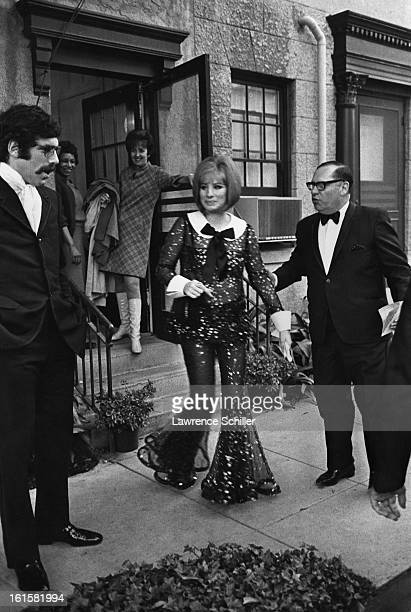 Married American actors Elliott Gould and Barbra Streisand with her press agent Lee Solters leave for the Academy Awards Los Angeles California April...