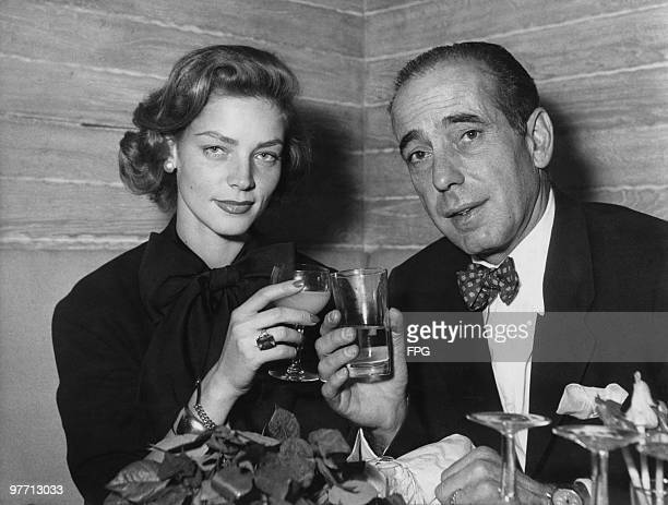 Married American actors Humphrey Bogart and Lauren Bacall attend a cocktail party at the Calvados cabaret club on the Champs Elysees Paris 1951