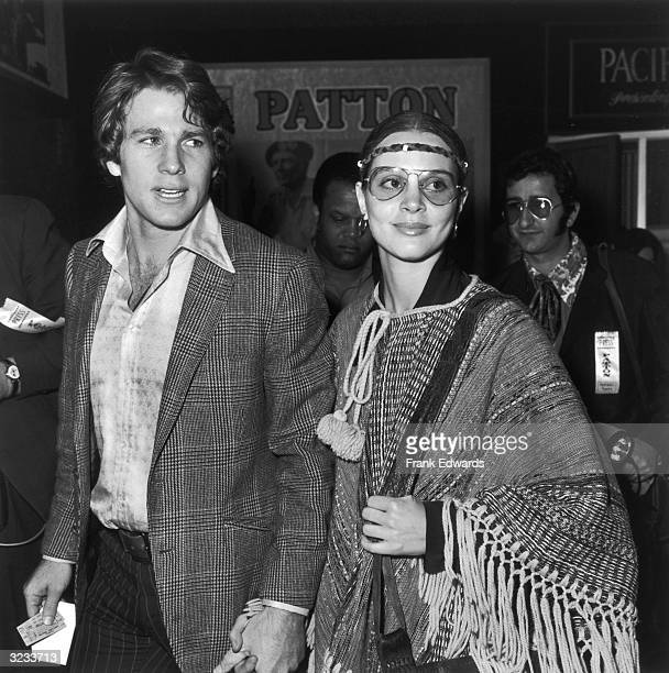 Married American actors Leigh TaylorYoung and Ryan O'Neal attend the premiere of the film 'Patton' at Pantages Theatre Hollywood 18th February 1970...