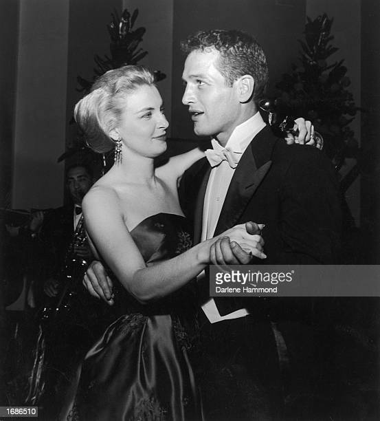 Married American actors Paul Newman and Joanne Woodward share a dance as Woodward holds her Best Actress Oscar statuette during the Academy Awards...
