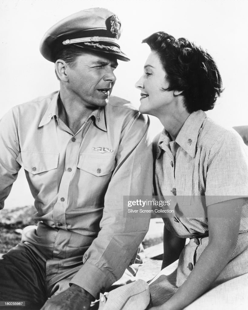Married American actors Ronald Reagan as Commander Casey Abbott and Nancy Davis as Nurse Lt Helen Blair in 'Hellcats Of The Navy' directed by Nathan...