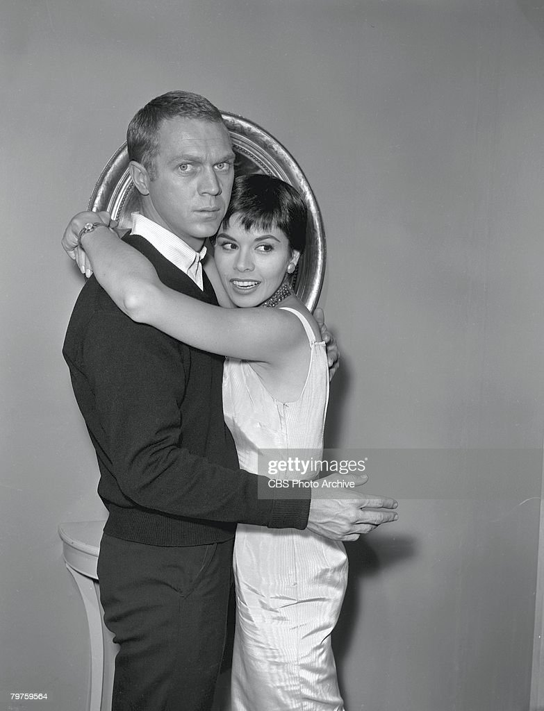Married American actors Steve McQueen (1930 - 1980) and Neile Adams embrace during the filming of an episode of the television anthology series 'Alfred Hitchcock Presents' entitled 'Man from the South,' December 23, 1959. The episode, directed by Norman Lloyd, was originally broadcast on January 3, 1960.