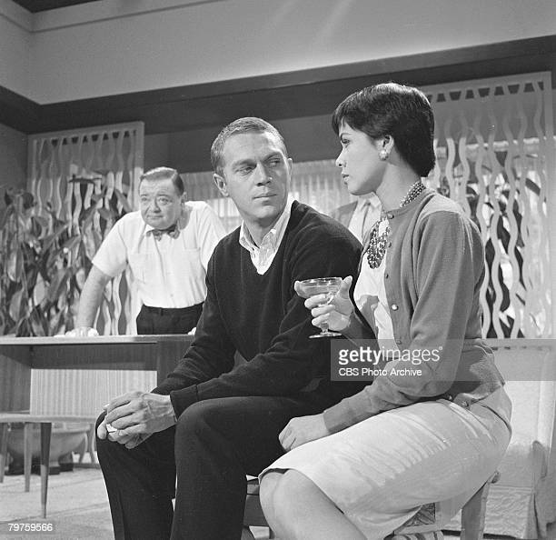 Married American actors Steve McQueen and Neile Adams talk while Hungarianborn American actor Peter Lorre stands in the background during the filming...