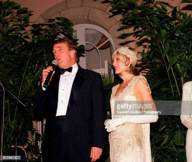 Married American couple real estate developer Donald Trump and actress Marla Maples stand onstage during a 'roaring 20's' party at the MaraLago...