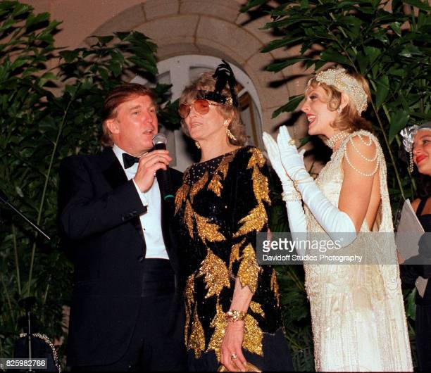 Married American couple real estate developer Donald Trump and actress Marla Maples stand with former competative swimmer Marjorie Post Dye on stage...