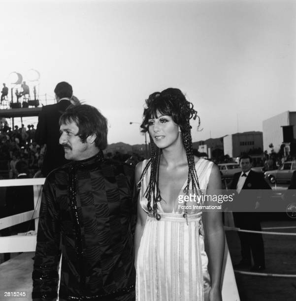 Married American pop singing duo Sonny Bono and Cher attend the Academy Awards ceremony at the Santa Monica Civic Auditorium Santa Monica California...