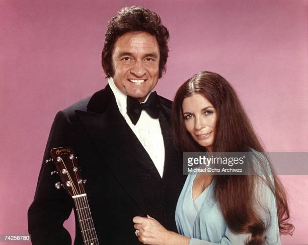 Married country singers Johnny Cash June Carter Cash pose for a portrait in circa 1975