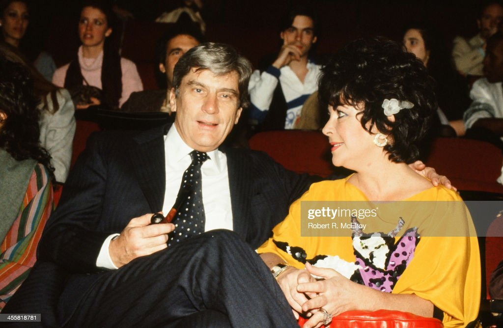 Married couple American politician John Warner and actress Elizabeth Taylor (1932 - 2011) attend a Michaele Vollbracht fashion show, New York, 1981.