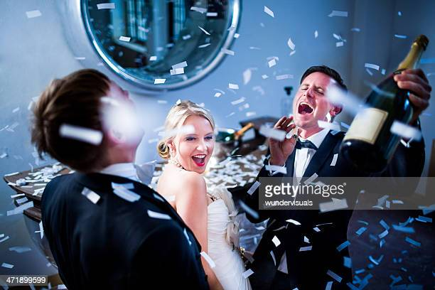 Married Couple celebrating wedding with champagne