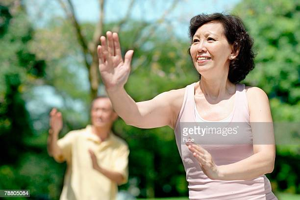 Married Couple Practicing Tai Chi