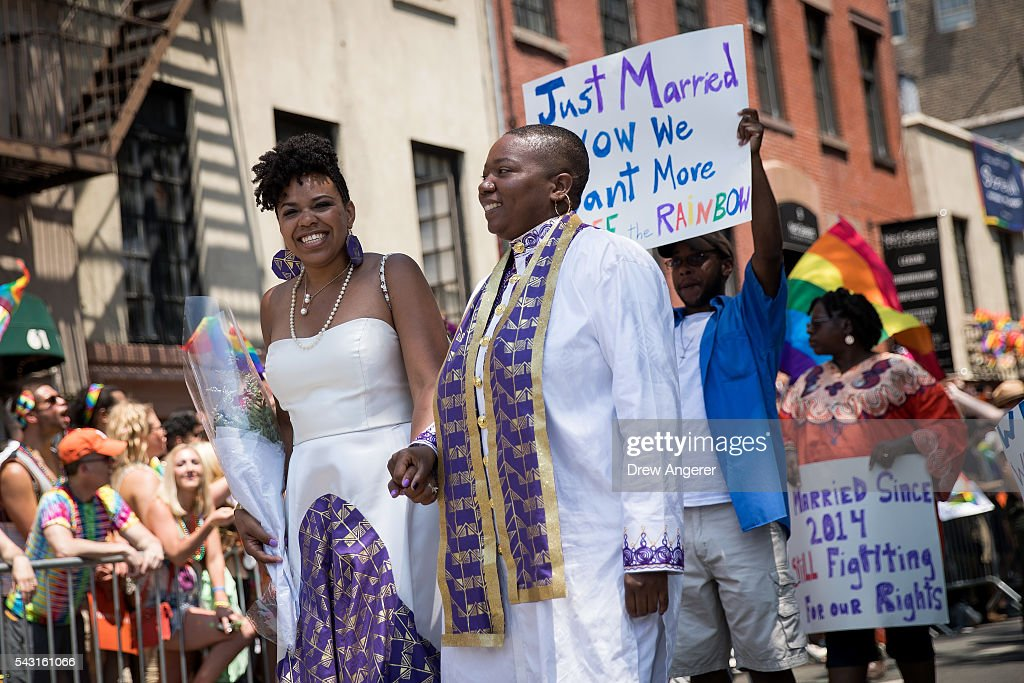 A married couple smile at the crowd as they march in New York City Pride March, June 26, 2016 in New York City. This year was the 46th Pride march in New York City.