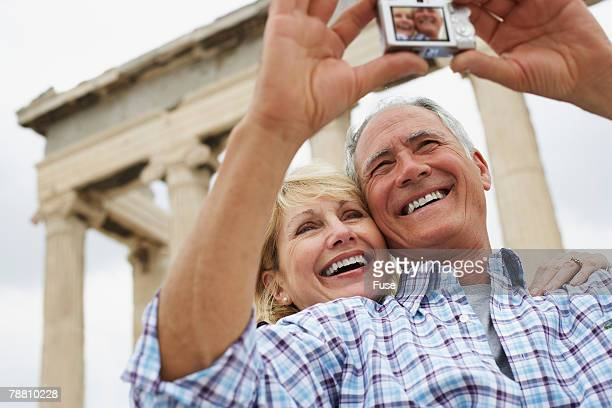 Married Couple Taking a Digital Photograph