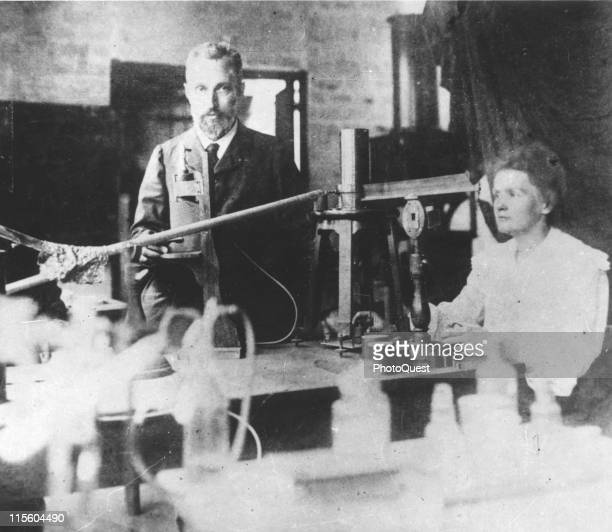 Married Nobel laureate scientists Pierre and Marie Curie pose in their laboratory Paris France early 1900s