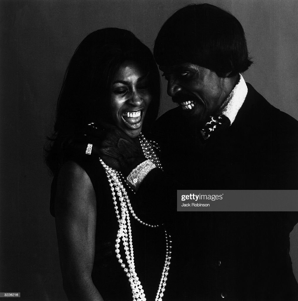 Portrait of married American rock musicians Ike and Tina Turner, with Ike pretending to strangle Tina. Tina later charged Ike with spousal abuse.