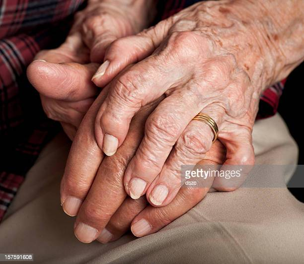 married senior couple holding hands