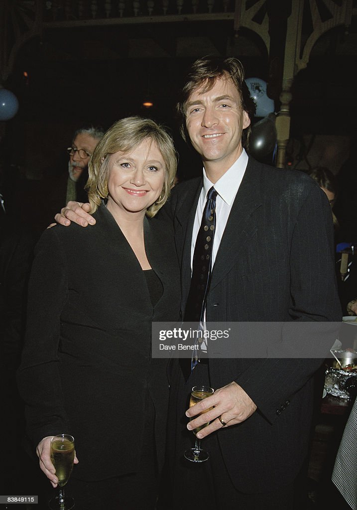 Married TV presenters Richard Madeley and Judy Finnigan attend a performance of the musical 'Heathcliff' at Labatts Apollo, London, 12th February 1997.