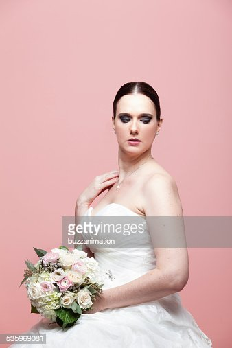 Married woman staring at the ground. : Stock Photo