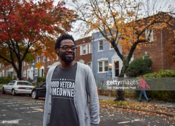 Marrio Pearson who served in the US Army from 1990 to 1999 looks out into his new neighborhood in front of his southeast DC rowhouse on Sunday...