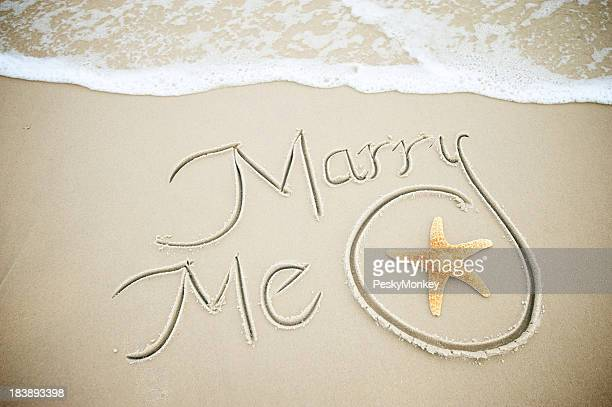 Marry Me Message Handwritten in Sand with Starfish