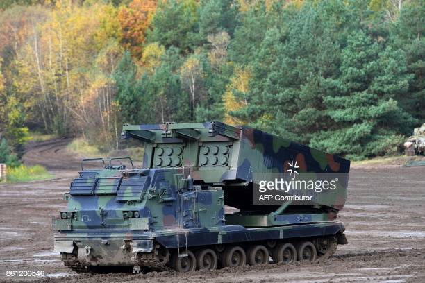 A 'Mars 2' rocket launcher of the German armed forces Bundeswehr drives through the mud during the informative educational practice 'Land Operation...