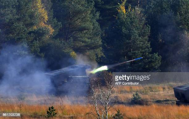 A 'Mars 2' rocket launcher of the German armed forces Bundeswehr fires during the informative educational practice 'Land Operation Exercise 2017' at...