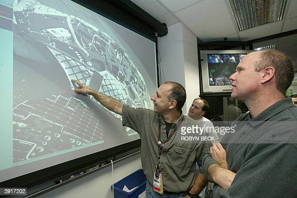 Mars Exploration Rover science surface test bed lead John Wirth and technical uplink lead Art Thompson admire images of the empty Opportunity rover...