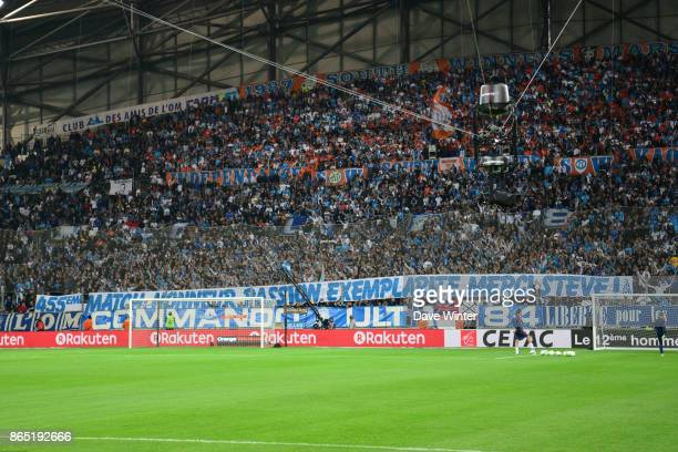 Marseille fans hold up a banner celebrating the 455th appearance by goalkeeper Steve Mandanda of Marseille during the Ligue 1 match between Olympique...