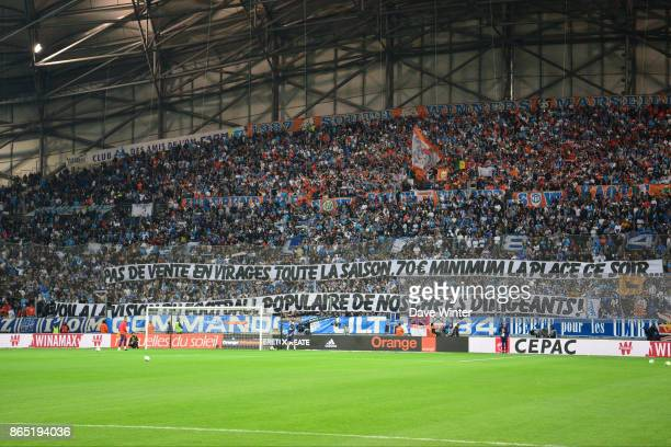 Marseille fans hold up a banner during the Ligue 1 match between Olympique Marseille and Paris Saint Germain at Stade Velodrome on October 22 2017 in...