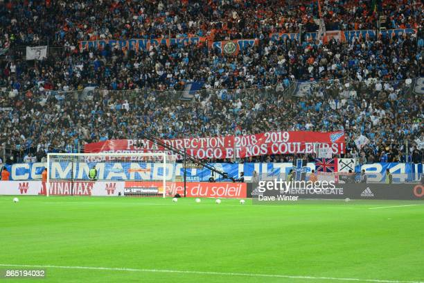 Marseille fans hold up a banner referring to the change of kit manufacturer for next season during the Ligue 1 match between Olympique Marseille and...