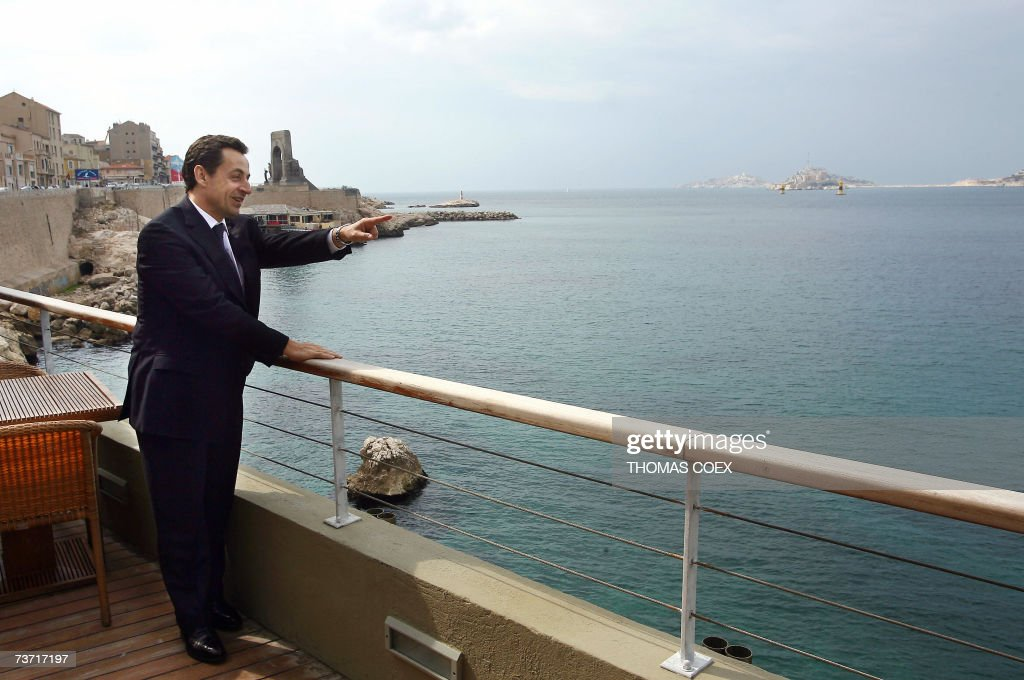 French right-wing presidential candidate Nicolas Sarkozy gestures in front of the mediteranean sea during his campaign visit in the French southern city of Marseille, 27 March 2007. AFP PHOTO THOMAS COEX