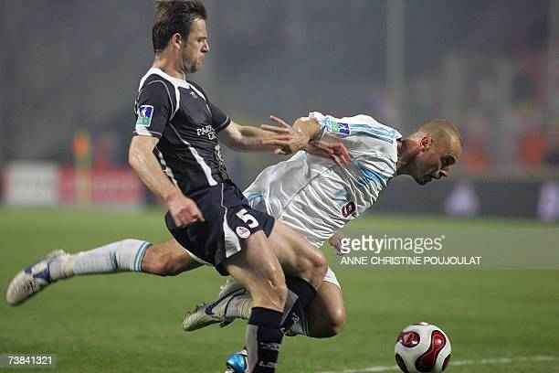 Marseille france marseilles forward mickael pagis vies with lilles