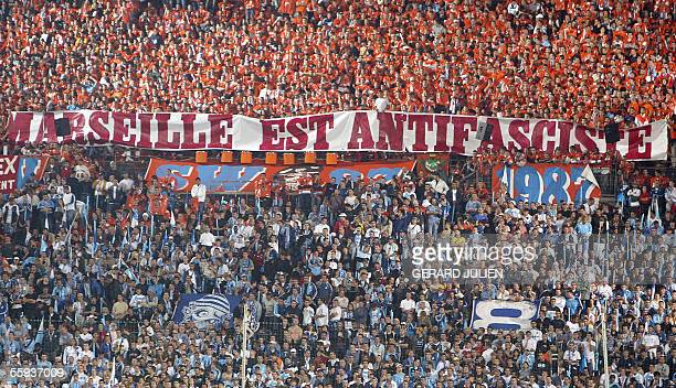 Marseille's supporters hold a banner 'Marseille is antifascit' during the French L1 football match Olympique de Marseille vs Paris SaintGermain at...