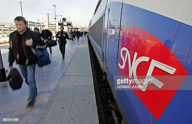 Travellers of the SNCF France's state rail company walk on a platform after leaving a train 22 November 2005 at the Marseille SaintCharles railway...