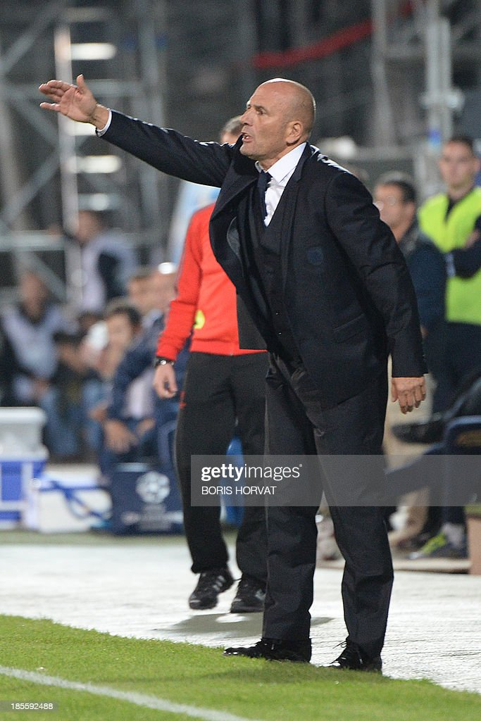 Marseille head coach Elie Baup gestures on October 22, 2013 during a UEFA Champion's league Group F football match against Napoli at the Velodrome stadium in the southern French city of Marseille.