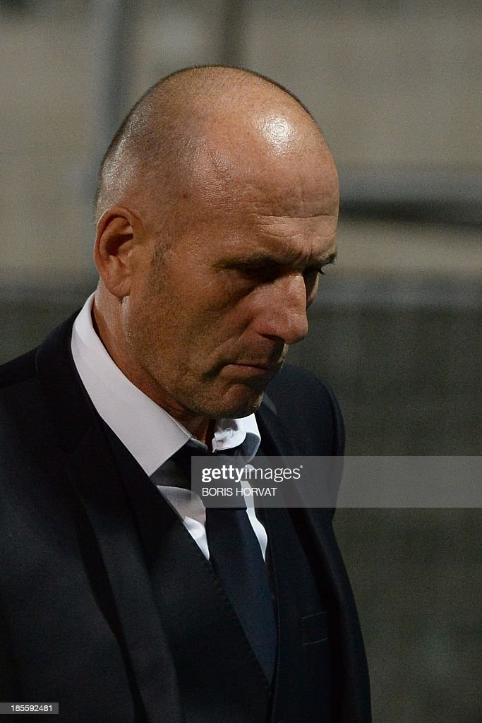Marseille head coach Elie Baup leaves the pitch on October 22, 2013 after a UEFA Champion's league Group F football match against Napoli at the Velodrome stadium in the southern French city of Marseille.