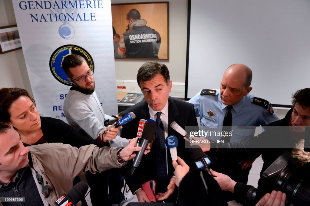 Marseille prosecutor Jacques Dallest (C) and regional commander of the Gendarmerie David Galtier (R) speak to the press in Marseille on January 18, 2013 following a raid on a cocaine laboratory in Marseille. The police raid netted 2.5kg of pure cocaine with cutting agents, 5 assault rifles and 19kg of ammunition. JULIEN