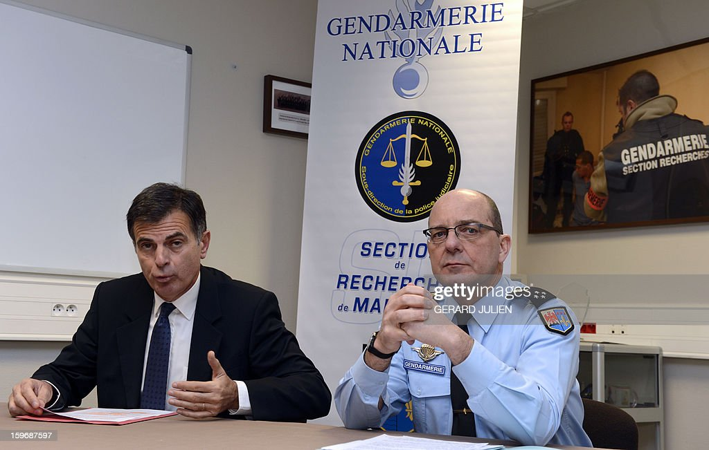 Marseille prosecutor Jacques Dallest (L) and regional commander of the Gendarmerie David Galtier speak at a press conference in Marseille on January 18, 2013 following a raid on a cocaine laboratory in Marseille. The police raid netted 2.5kg of pure cocaine with cutting agents, 5 assault rifles and 19kg of ammunition. JULIEN