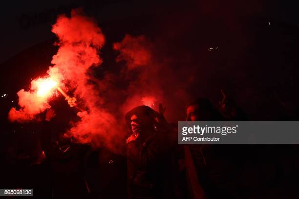 A Marseille supporter burns a flare a few hours prior to kick off of the French L1 football match between Marseille and Paris SaintGermain on October...