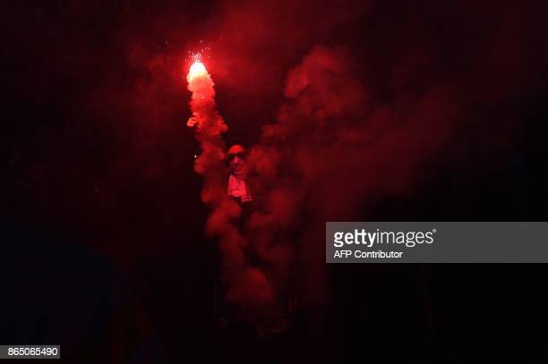 Marseille supporter burns a flares a few hours prior to kick off of the French L1 football match between Marseille and Paris SaintGermain on October...