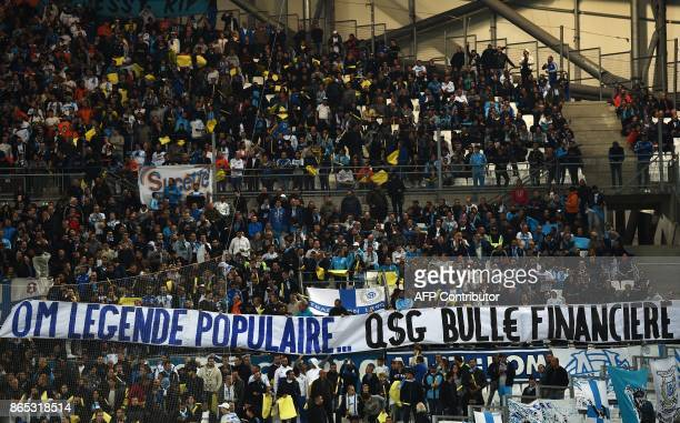 Marseille supporters hold a banner on October 22 2017 at the Velodrome stadium in Marseille southern France during the French L1 football match...