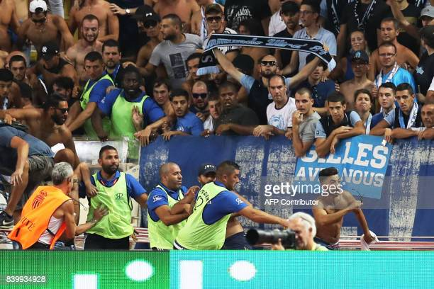 Marseille supporters invade the pitch during the French L1 football match between Monaco and Marseille on August 27 at the Louis II Stadium in Monaco...