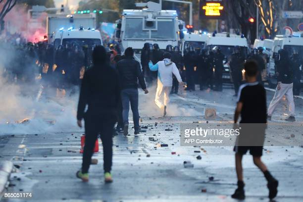 Marseille supporters stand in the road as they face police a few hours prior to kick off of the French L1 football match between Marseille and Paris...