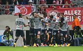Marseille teammates celebrate after Marseille's Ghanaian forward Andre Ayew scored a goal on September 23 2014 during a French L1 football match...