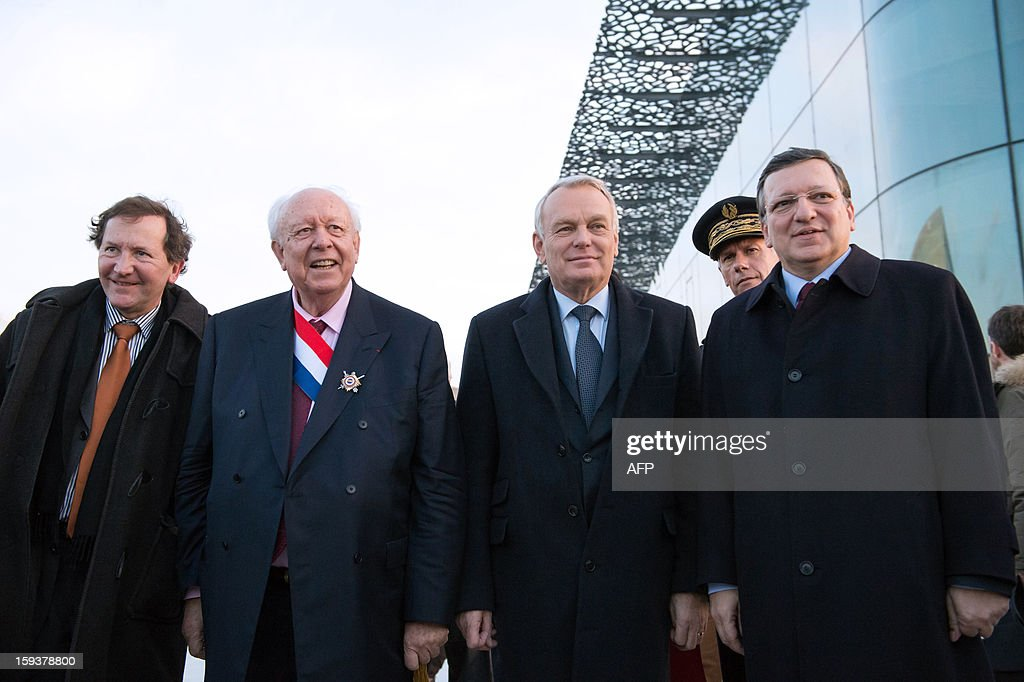 Marseille-Provence 2013 European Capital of Culture association president Jacques Pfister, EU Commission President Jose Manuel Barroso, France's Prime Minister Jean-Marc Ayrault and Marseille Mayor Jean-Claude Gaudin arrive to visit the Saint-Jean fort work area as part of the opening Ceremony of Marseille-Provence 2013 European Capital of Culture on January 12, 2013 in Marseille, southern France.