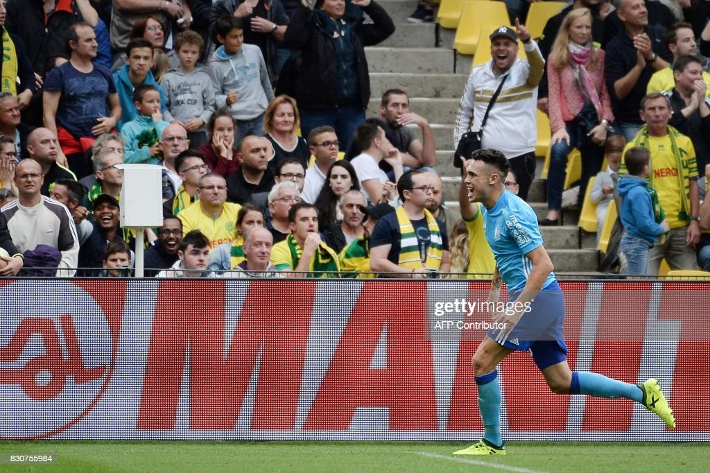 Marseille's Argentinian forward Lucas Ocampos celebrates after scoring a goal during the French L1 football match between Nantes (FCN) and Olympique de Marseille (OM) on August 12, 2017 at the Beaujoire stadium of Nantes, western France. /