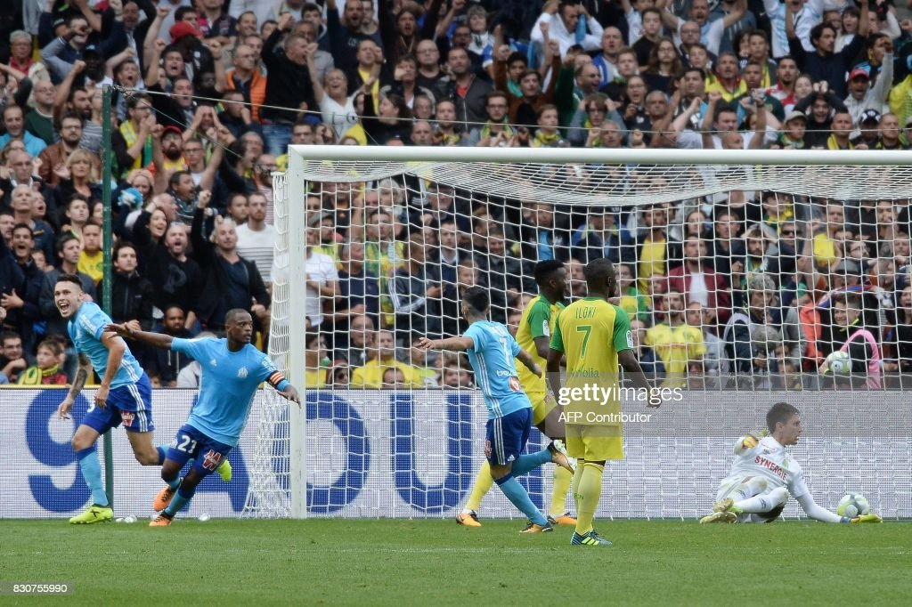 Marseille's Argentinian forward Lucas Ocampos (L) celebrates after scoring a goal during the French L1 football match between Nantes (FCN) and Olympique de Marseille (OM) on August 12, 2017 at the Beaujoire stadium of Nantes, western France. /