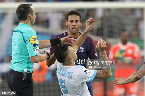 TOPSHOT Marseille's Argentinian forward Lucas Ocampos falls after an altercation with Paris SaintGermain's Brazilian forward Neymar during the French...
