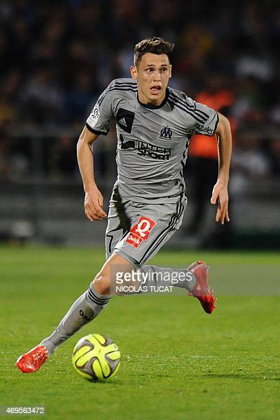 Marseille's Argentinian forward Lucas Ocampos runs with the ball during a French L1 football match between Bordeaux and Marseille on April 12 2015 at...